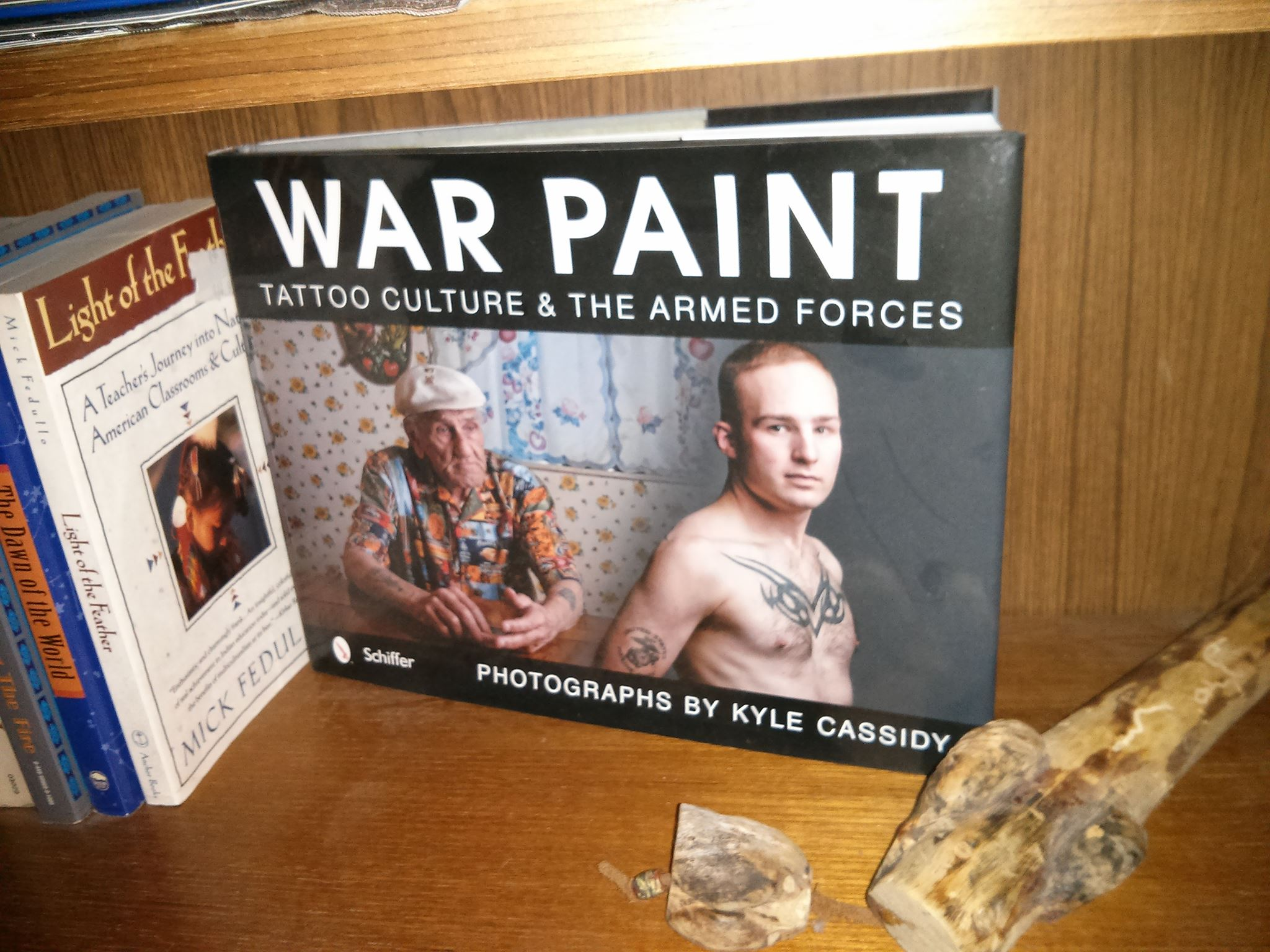Another of Kyle Cassidy's great works that get people talking. Yes, that's a Tribal Talking Stick sitting next to it on my bookshelf.