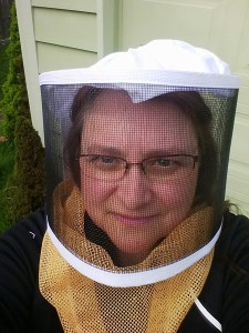 The author in her beekeeping veil.