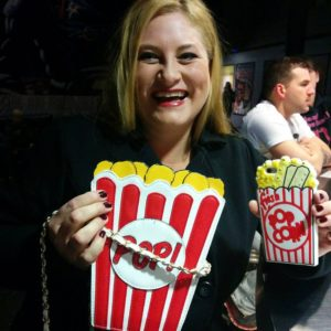 My dear friend, Tonya, who really knows how to get amp'd up for a double-date movie night. Her Popcorn purse and cellphone case. Is she not adorable?