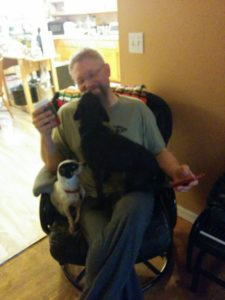 The Earl and his Dogs. Seriously, if he's sitting they are in his lap. Can't even have a cup of coffee without their canine love. ;)